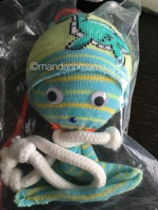 A little sock doll Cookie Monster made.