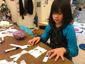 Child putting together a Chinese puzzle