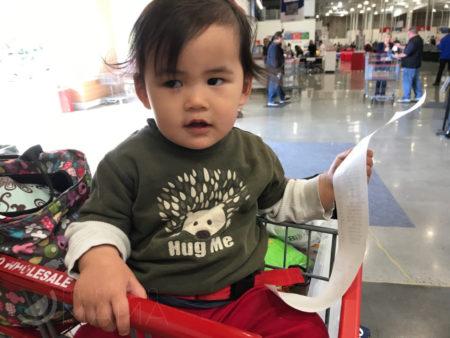 toddler in shopping cart