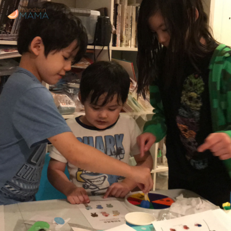 Two boys and a girl doing I Luv Chinese crafts.